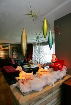 "The living room in the home of Joe Valenti is decorated for entertaining in ""Mad Men"" style for the holidays Tuesday, Dec. 8, 2009 in Cleveland, Ohio. (Karen Schiely/Akron Beacon Journal)"